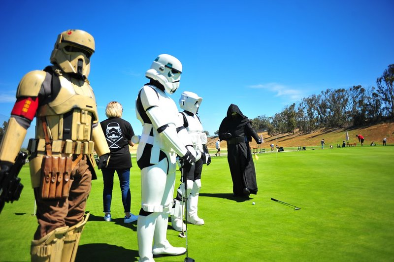 Star Wars characters golfing.