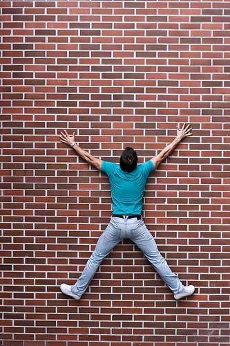 Man Stuck to Brick Wall