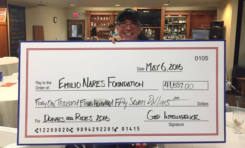 Richard Nares holding a giant check.