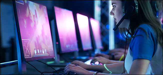 a girl playing a PC game