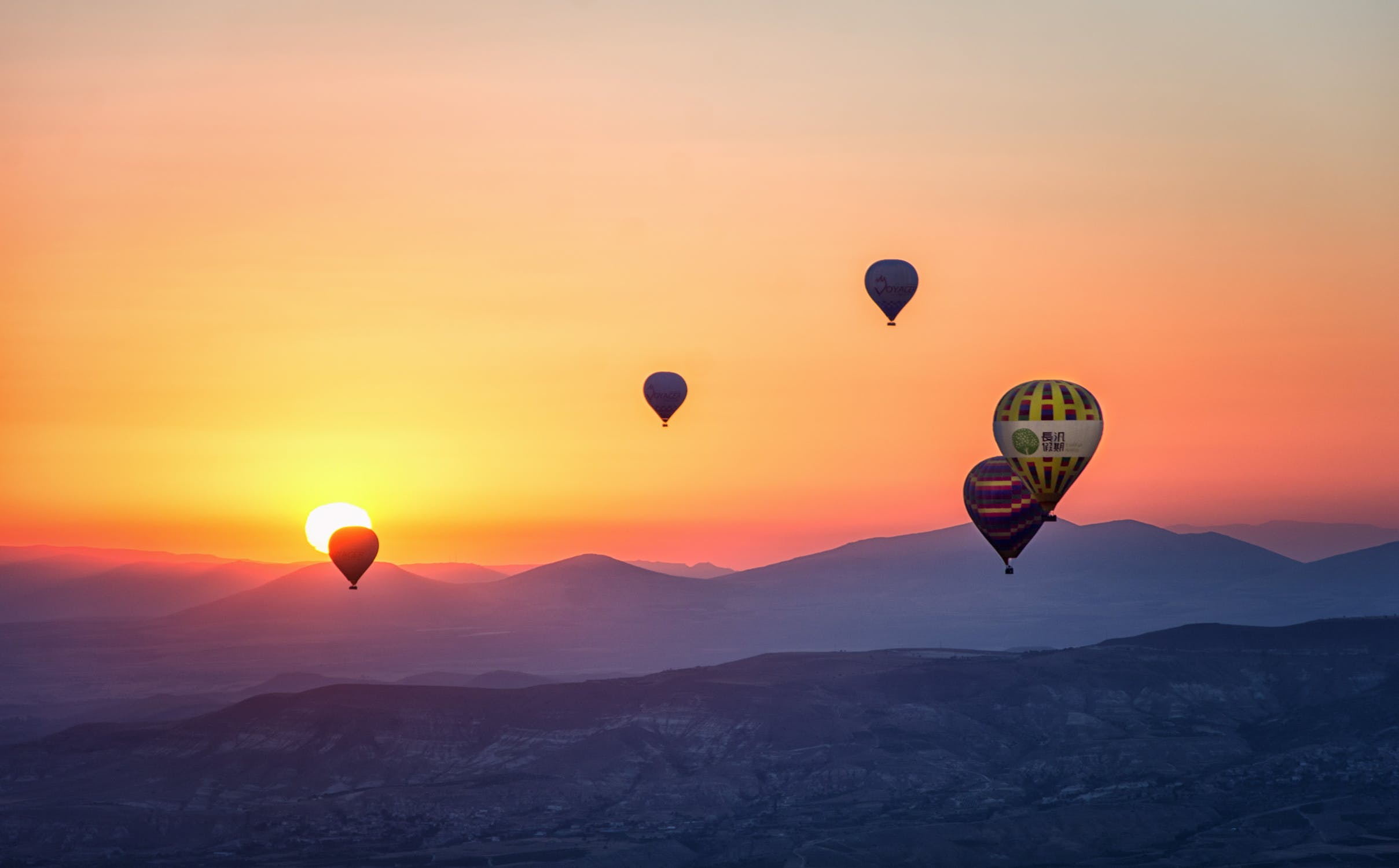 Hot air balloons in the sky during sunset.