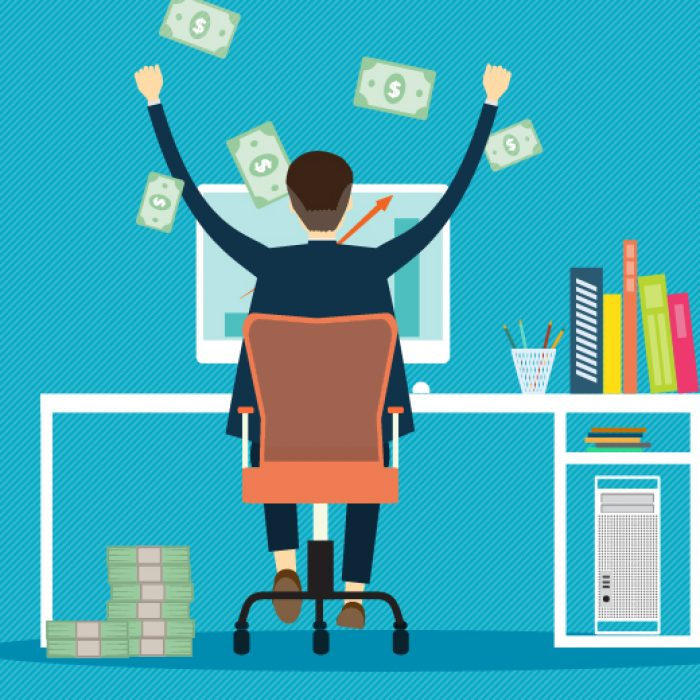 Man sitting at his desk in front of his computer with his hands up in joy. There's money all around him.