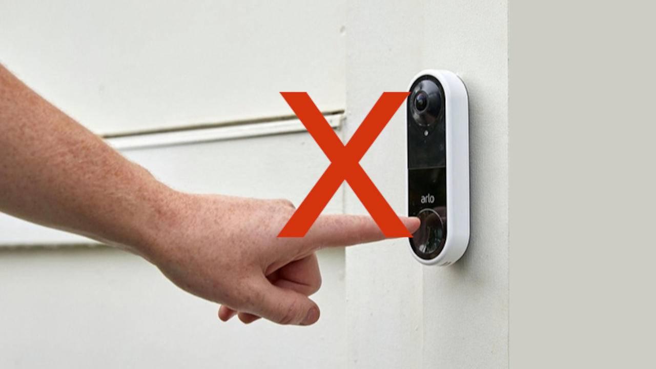Finger touching a door bell